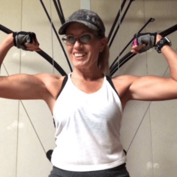 A woman working out with a big smile on her face