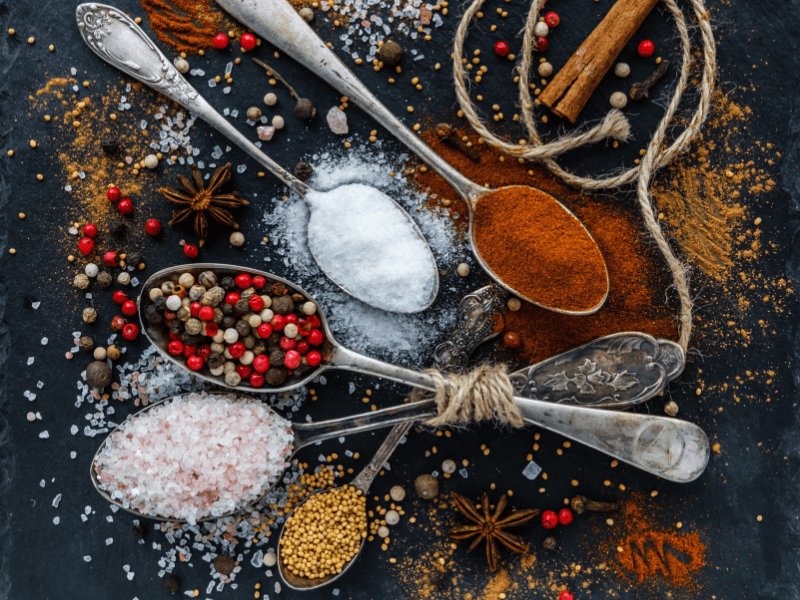 Some spices strewn across a table