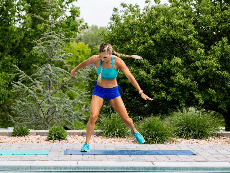 Trainer Lindsey doing exercises by the pool.