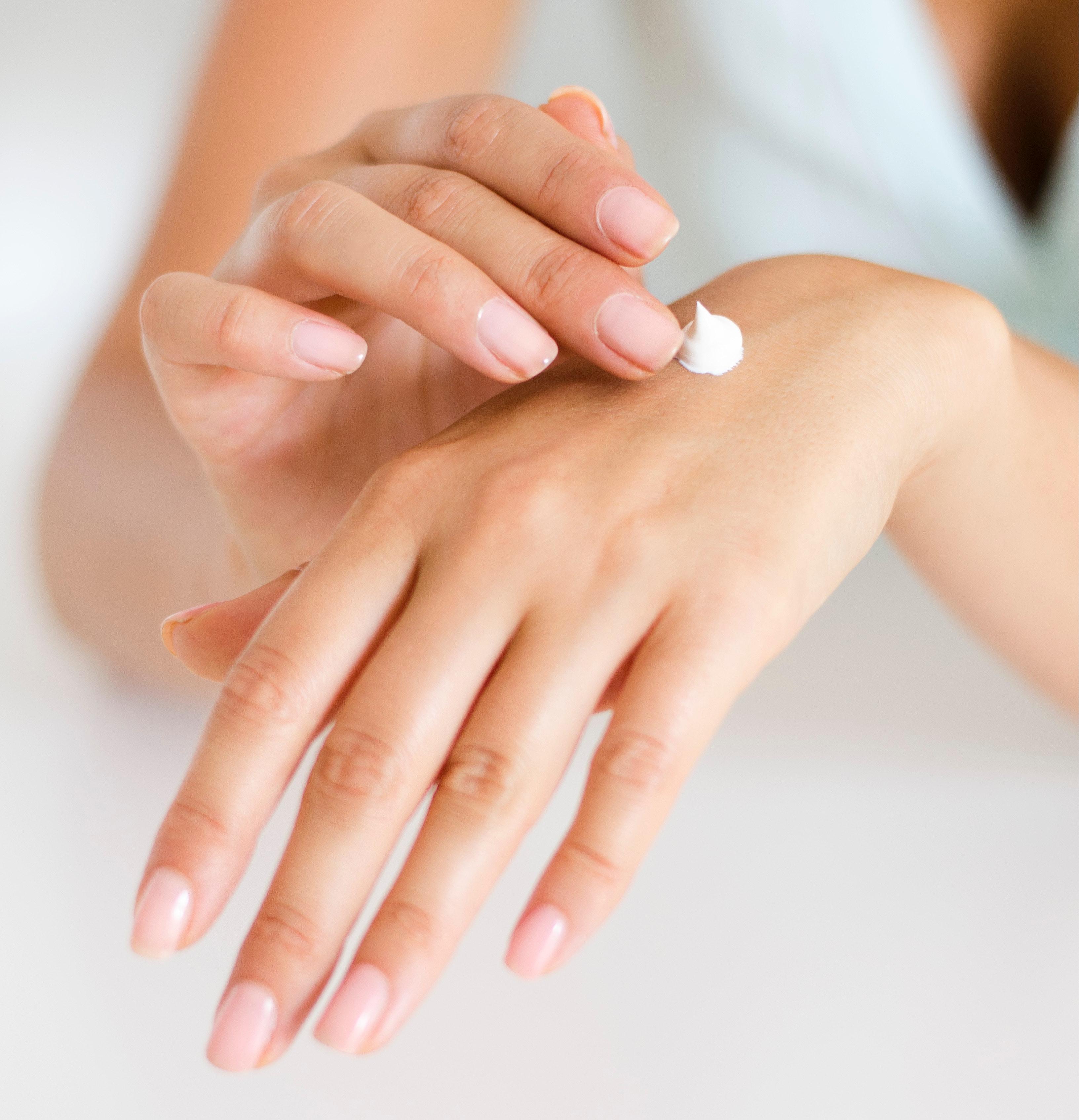 Image of hand applying hand cream