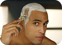 Man shaving head with Gillette Proshield razor