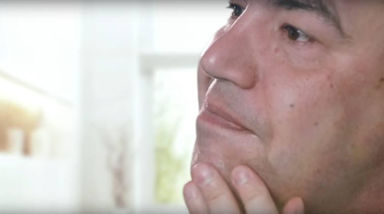 Man touching chin