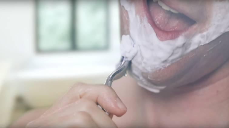 Man shaving harshly
