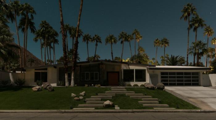 Tom Blachford Midnight Modern: A bungalow below a skyline of palm trees.