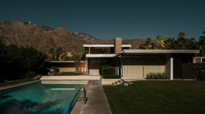Tom Blachford Midnight Modern: A futuristic home and a swimming pool set against mountains.
