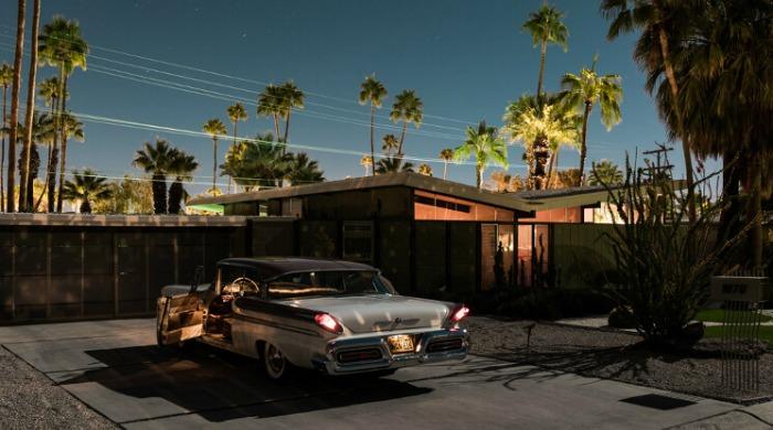 Tom Blachford Midnight Modern: A silver classic car beneath a skyline filled with palm trees.