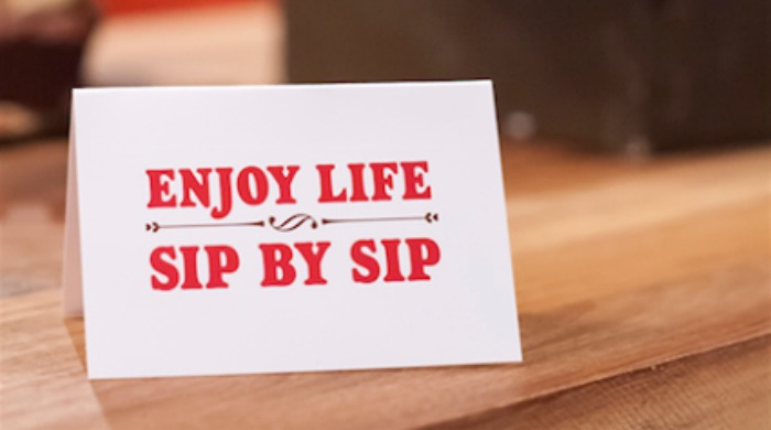 """A sign that reads """"Enjoy life sip by sip"""" at the Teacup Kitchen."""