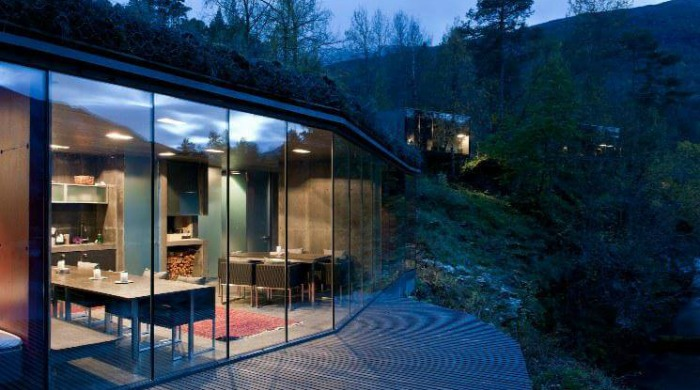The Juvet Hotel Norway: An outside view of the dining area with an exterior glass wall.
