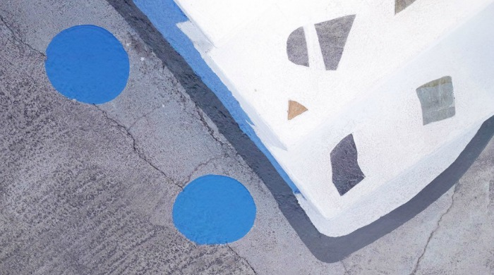 The Voyageur: An abstract painting on a pavement.