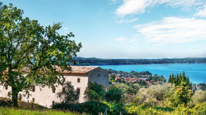 Prati Palai, Lake Garda: A view from behind the farmhouse looking out on to the bright blue lake.