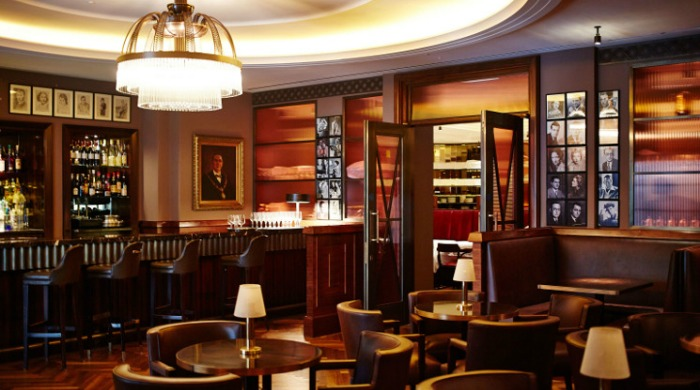The Beaumont Hotel, London: The American Bar with black and white photographs on the walls and retro American interior design.