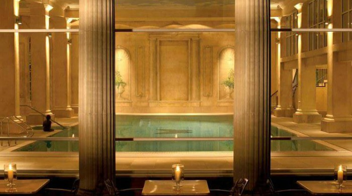 Five of the Best UK Spas: A beautiful indoor pool at Chewton Glen Hotel & Spa surrounded by Roman columns.