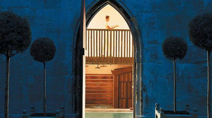Five of the Best UK Spas: A view through an arch doorway into the spa with the pool visible.