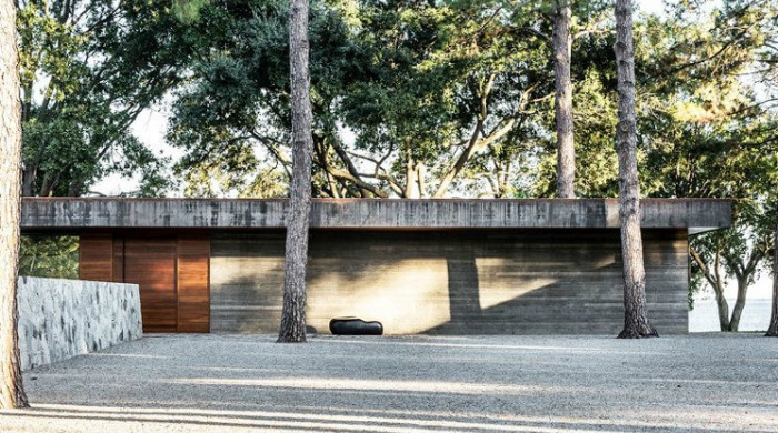 An exterior shot of the CCR1 Residence surrounded by forest in the background.