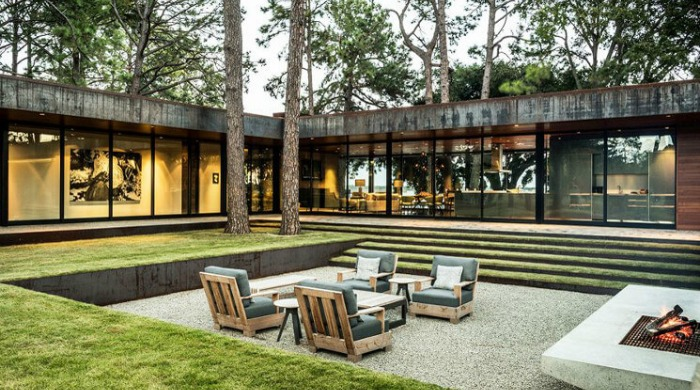 The outdoor seating area and firepit of the CCR1 Residence.