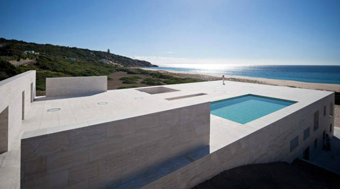 The roof of the house of the infinite with a rooftop pool and views onto the sea.