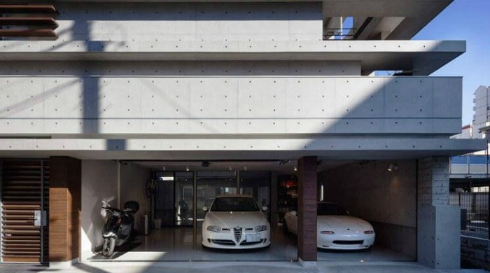 Garages with white cars in them in the cranks house by Hugo Kohno.