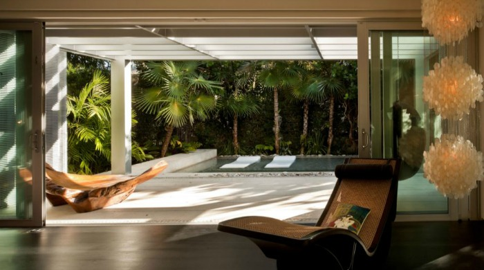 The living area looking out onto the pool area of a minimal Miami beach house.