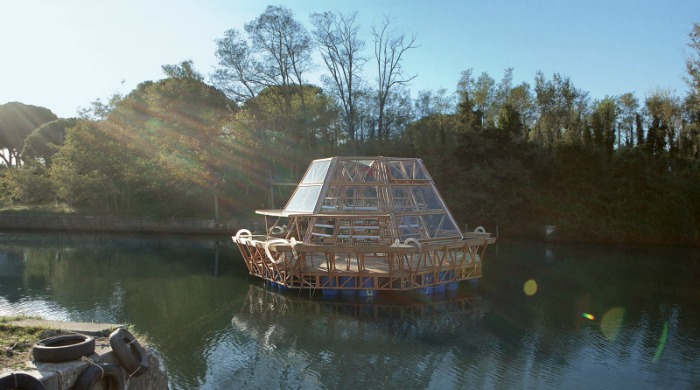 The Jellyfish Barge floating on a river.