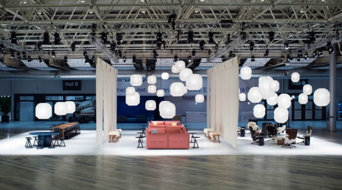 Barber & Osgerby's installation featuring pink sofas with many white Hotaru hanging lanterns at the Stockholm Furniture and Light Fair 2016.