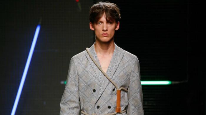 A male model wearing a grey MSGM jacket.