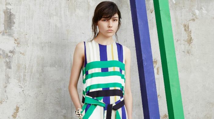 A model wearing a striped MSGM dress.