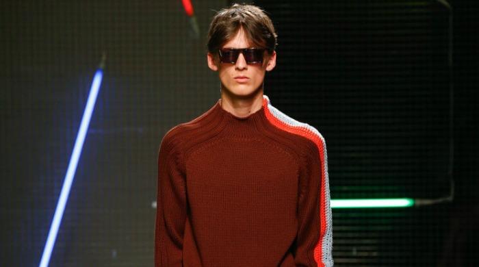 A male model wearing an MSGM jumper.