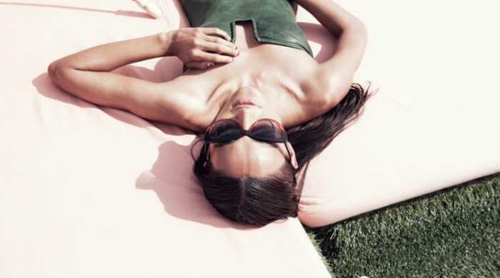 A model wearing Prism sunglasses.
