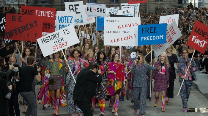 Chanel's SS15 show on the runway in the form of a feminist rally.