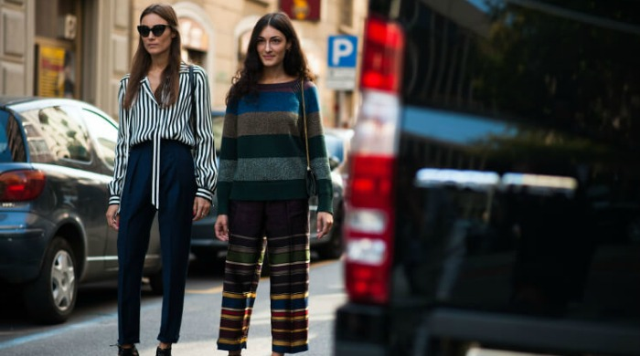 Two stylish women on the streets of Italy.