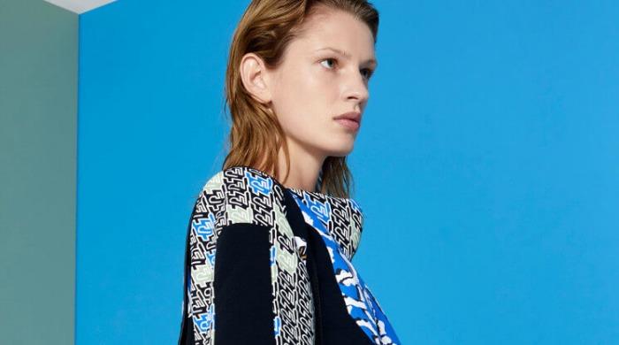 A model wearing a KENZO jumper.