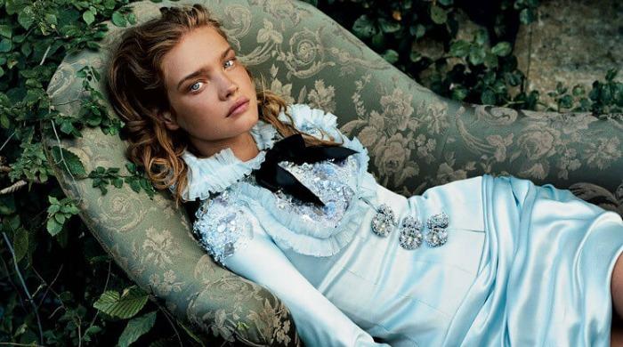 A model posing for an Alice in Wonderland-inspired shoot.