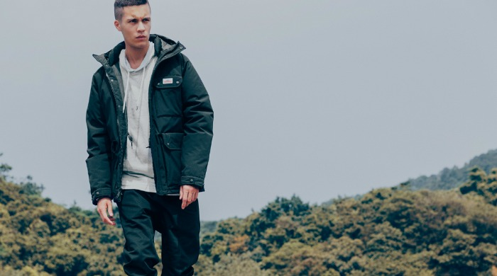 A male model wearing Penfield clothing.