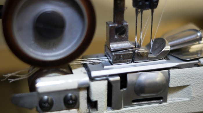 An old sewing machine in action at the Tripl Stitched factory.