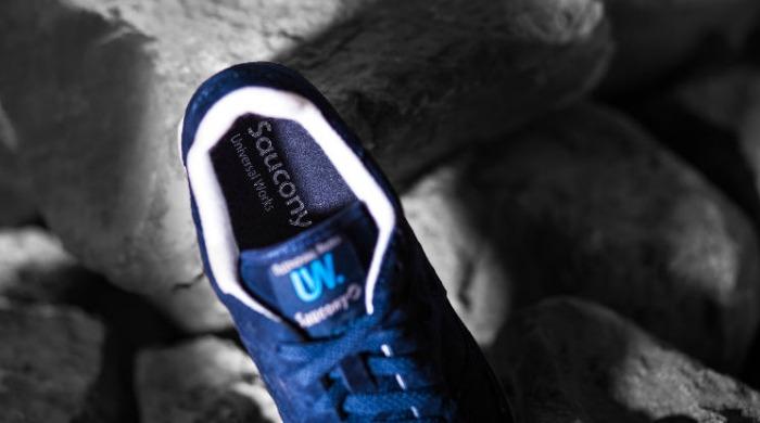 A blue Saucony Originals x Universal Works trainer.