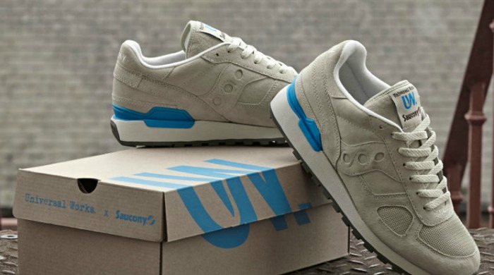 A pair of grey Saucony Originals x Universal Works trainers.