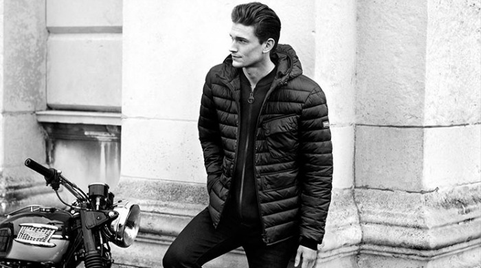 A male model wearing Barbour International clothing.