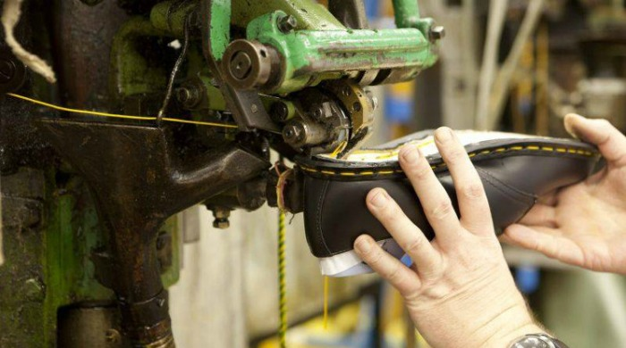 A Dr. Martens Made In England shoe being made.