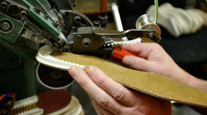 A sole being made at the Tricker's factory.