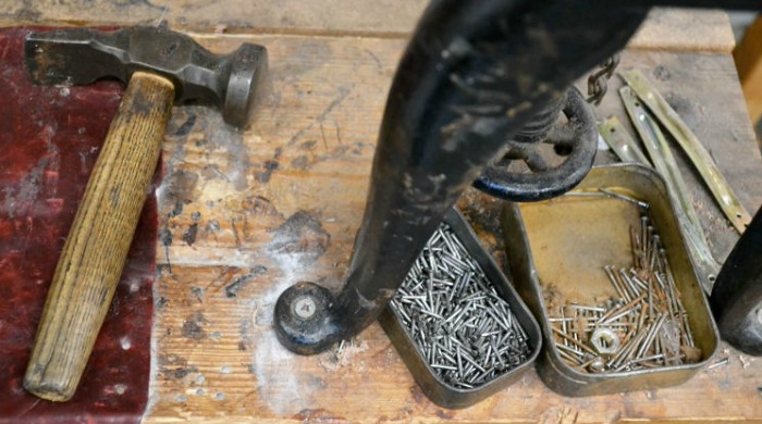 A hammer and nails at the Tricker's factory.