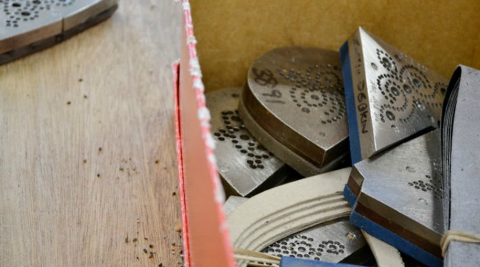 A box of different patterns for brogue detailing.