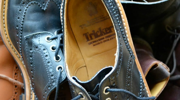 A pair of black Tricker's shoes.