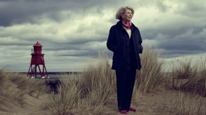 Dame Margaret Barbour on a beach.