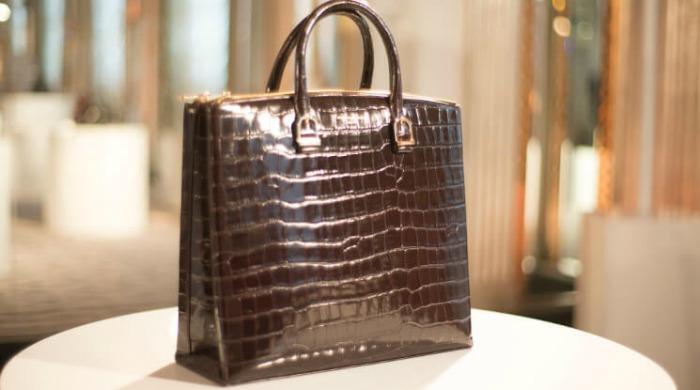A burgundy handbag at the Aspinal of London AW16 presentation.