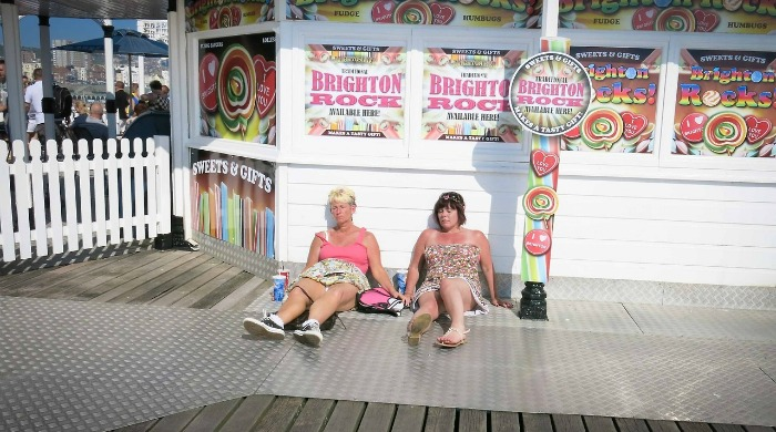 Tourists asleep on the pier from the 'It's a Brighton Thing' series by Azzurra Biagi.