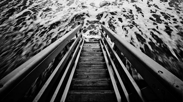 A staircase into the sea in black and white by Guy Cohen.