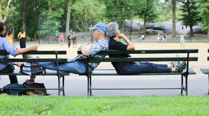 An old couple leaning against each other on a park bench from Humans of New York.