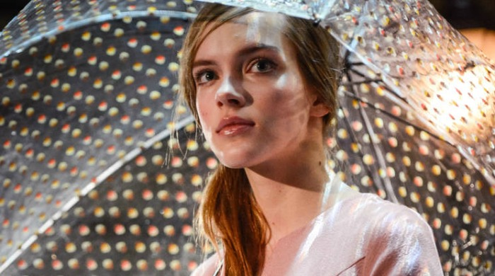 A model holding an umbrella at the Orla Kiely AW14 London Fashion Week show.