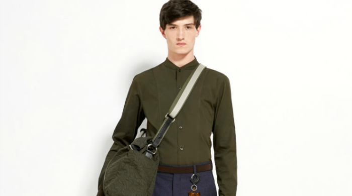 A male model wearing Carven clothing.