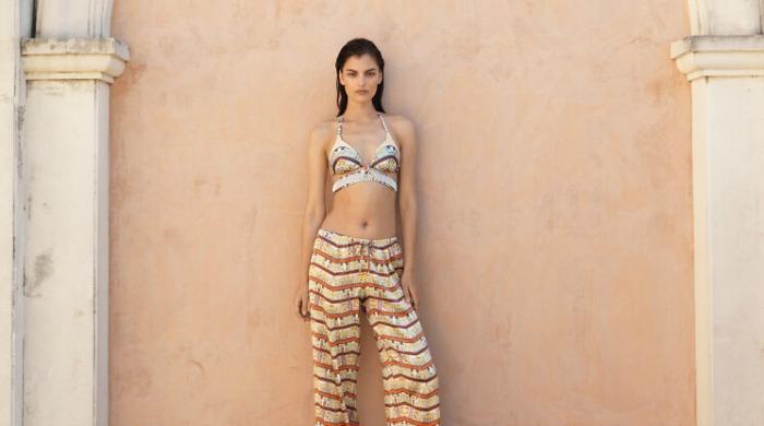 A model wearing a Paolita bikini top.